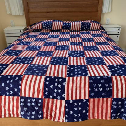 Picture of stars and stripes bed cover - reversible